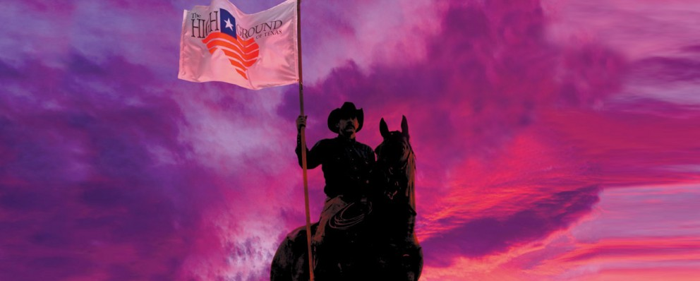 man on horseback with TX flag